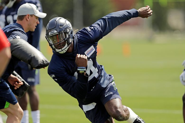 """In this Friday, May 3, 2019 photo, Seattle Seahawks rookie wide receiver DK Metcalf runs a drill during NFL football rookie mini camp in Renton, Wash. It took one rookie minicamp practice for Metcalf to catch the attention of Seahawks coach Pete Carroll. """"Maybe he's even more unique than we thought coming in,"""" Carroll says. (AP Photo/Ted S. Warren)"""
