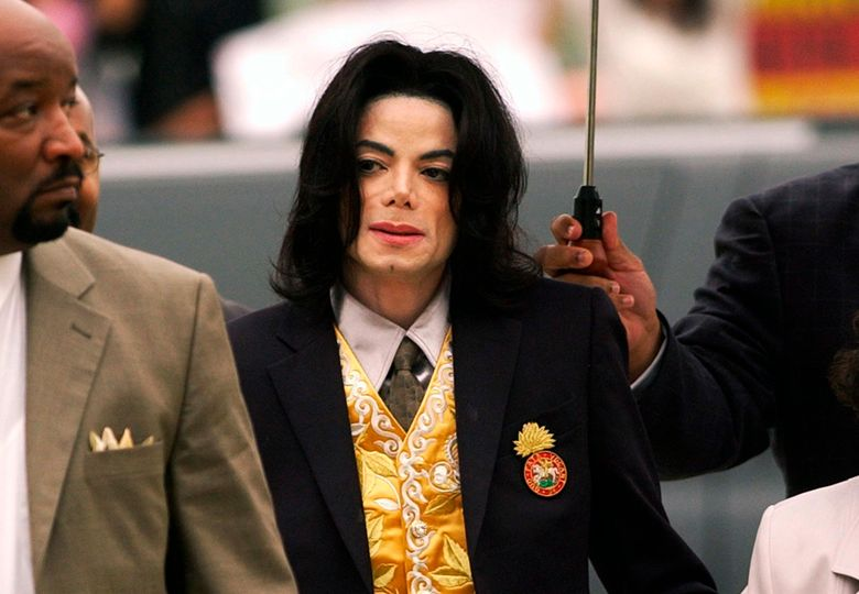 FILE – In this May 25, 2005 file photo, Michael Jackson arrives at the Santa Barbara County Courthouse for his trial in Santa Maria, Calif. A settlement has been reached in a lawsuit between Tohme Tohme, a former manager of Michael Jackson, and his estate. The settlement announced Thursday, May 23, 2019, ends one of the last remaining legal fights involving Jackson's estate and comes just short of the 10th anniversary of the pop superstar's death. (Aaron Lambert/Santa Maria Times via AP, Pool)