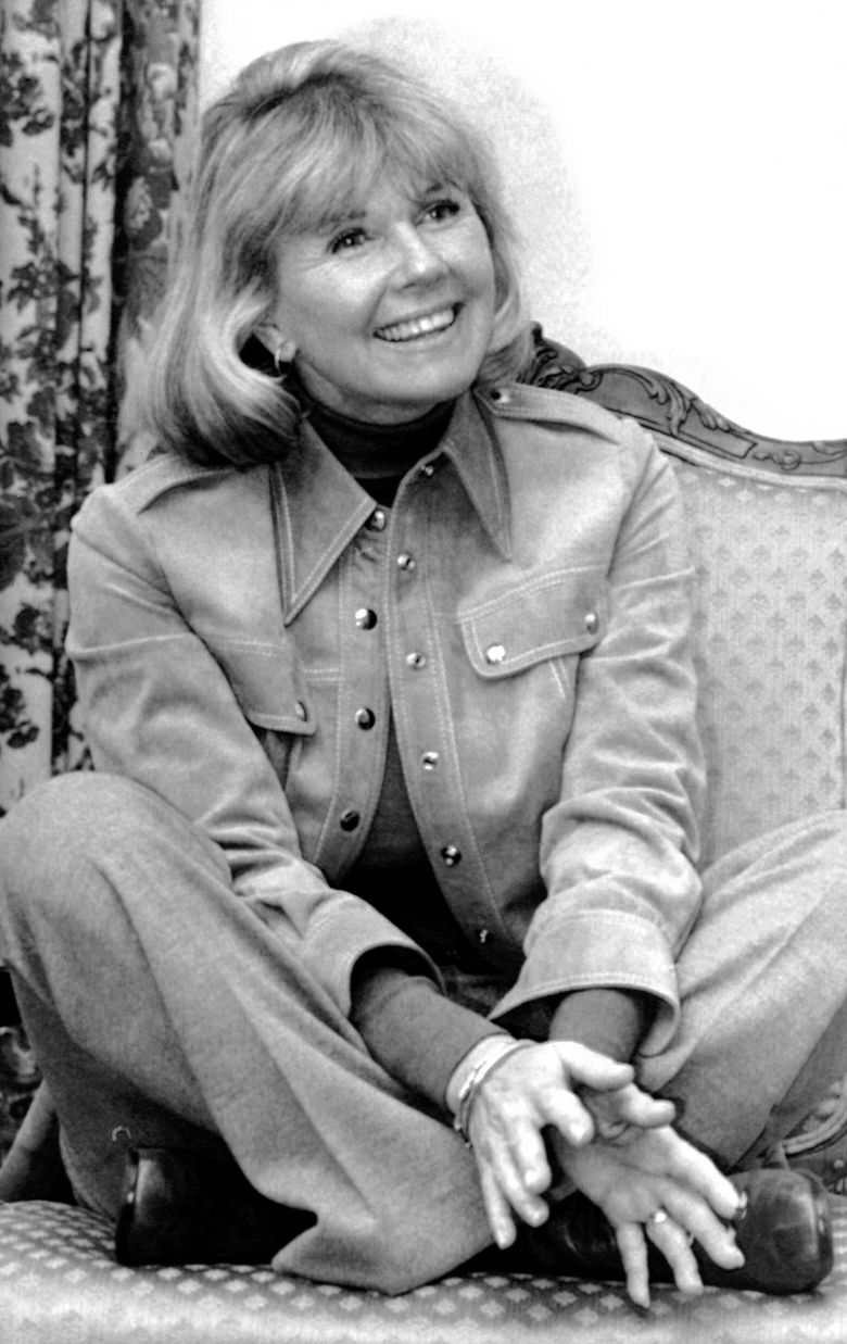 """In this Jan. 6, 1976 file photo, actress and singer Doris Day answers questions in New York, during an interview on the book """"Doris Day: Her Own Story,"""" written by A.E. Hotchner. Day, whose wholesome screen presence stood for a time of innocence in '60s films, has died, her foundation says. She was 97. The Doris Day Animal Foundation confirmed Day died early Monday, May 13, 2019, at her Carmel Valley, California, home.(AP Photo, File)"""