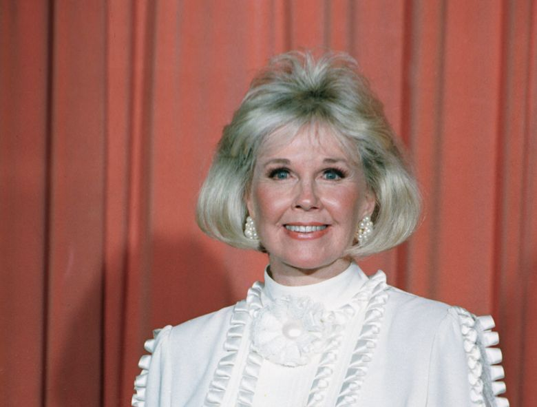 In this Jan. 28, 1989 file photo, actress and animal rights activist Doris Day poses for photos after receiving the Cecil B. DeMille Award she was presented with at the annual Golden Globe Awards ceremony in Los Angeles. Day, whose wholesome screen presence stood for a time of innocence in '60s films, has died, her foundation says. She was 97. The Doris Day Animal Foundation confirmed Day died early Monday, May 13, 2019, at her Carmel Valley, California, home. (AP Photo, File)