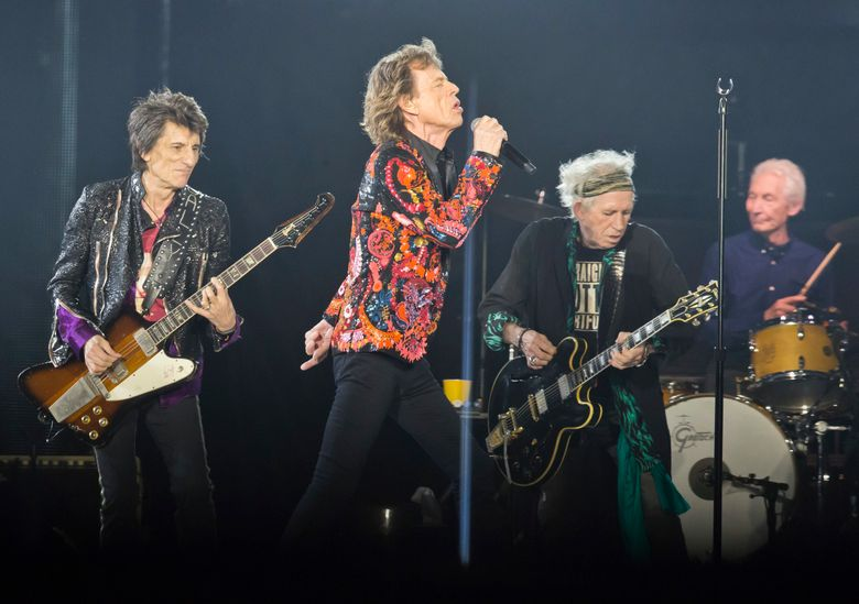 """FILE – In this Oct. 22, 2017, file photo from left, Ronnie Wood, Mick Jagger, Keith Richards and Charlie Watts of the Rolling Stones perform during the concert of their """"No Filter"""" Europe Tour 2017 at U Arena in Nanterre, outside Paris. The Rolling Stones are ready to get back on the road after postponing their North American tour because Mick Jagger needed medical treatment, reportedly for a heart valve issue. The rockers on Thursday, May 16, 2019, announced the No Filter tour will kick off in Chicago with two shows on June 21 and 25. (AP Photo/Michel Euler, File)"""