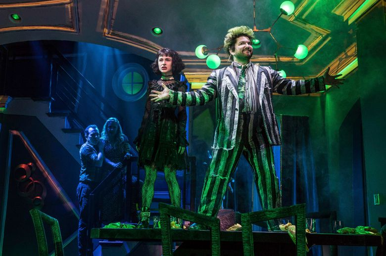 """This image released by Polk & Co. shows Rob McClure, from left, Kerry Butler, Sophia Anne Caruso and Alex Brightman during a performance of """"Beetlejuice,"""" in New York. The Tony-nominated """"Beetlejuice"""" is a stage adaptation of the Tim Burton dark comedy. (Matthew Murphy/Polk & Co. via AP)"""