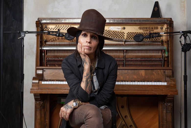 """In this Jan. 23, 2019 photo, Linda Perry poses for a portrait at her studio in Los Angeles. A benefit gala honoring Linda Perry will include a performance by Rock and Roll Hall of Famers Cheap Trick and appearances from Oscar-nominated actress Juliette Lewis and Perry's actress-wife, Sara Gilbert. """"Linda Perry & Friends: A Night at the GRAMMY Museum"""" will take place June 29 in Los Angeles at The Novo at L.A. Live. (Photo by Rebecca Cabage/Invision/AP)"""