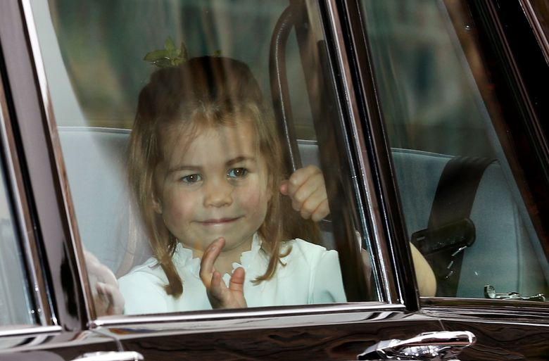 FILE – In this Friday, Oct. 12, 2018 file photo, Princess Charlotte waves as she arrives by car for the wedding of Princess Eugenie of York and Jack Brooksbank in St George's Chapel, Windsor Castle, near London, England. Kensington Palace said Friday, May 24, 2019 that four-year-old Charlotte will join her brother Prince George at Thomas's Battersea school in September.  (AP Photo/Alastair Grant, file)
