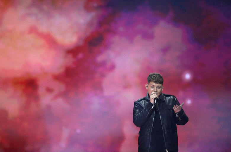 """FILE – In this Friday, May 17, 2019 file photo, Michael Rice of Great Britain performs the song """"Bigger Than Us"""" during the 2019 Eurovision Song Contest grand final rehearsal in Tel Aviv, Israel. Britain's Eurovision song """"Bigger Than Us"""" is an even bigger flop than previously thought after its last-placed entry was stripped of five points to correct a math error on Thursday, May 23, 2019.  (AP Photo/Sebastian Scheiner, file)"""