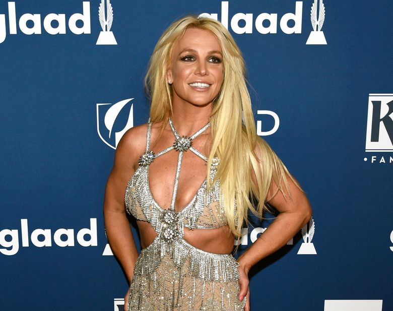 FILE – In this April 12, 2018 file photo, Britney Spears arrives at the 29th annual GLAAD Media Awards in Beverly Hills, Calif. Spears has been granted a restraining order against a former confidante who she says has been harassing her family. A judge Wednesday, May 8, 2019, ordered the man, 44-year-old Sam Lutfi, to stay at least 200 yards from Spears, her parents and her sons. (Photo by Chris Pizzello/Invision/AP, File)