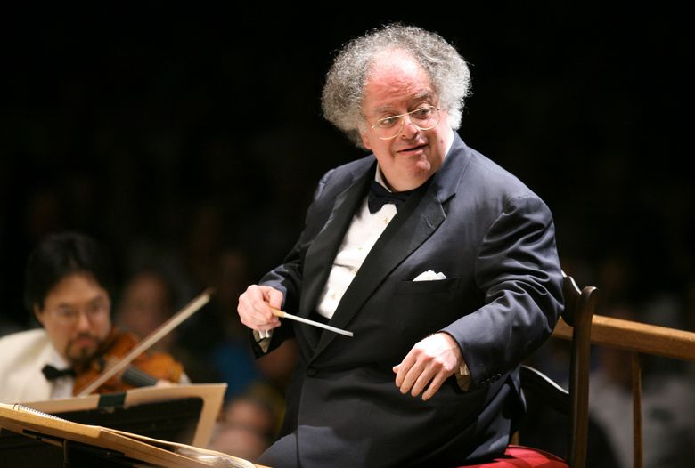 FILE – In this July 7, 2006 file photo, Boston Symphony Orchestra music director James Levine conducts the symphony on its opening night performance at Tanglewood in Lenox, Mass. Records show conductor James Levine's company received $936,755 from the Metropolitan Opera in his 47th and final season, a tenure cut short when he was fired as music director emeritus after an investigation found evidence of sexual abuse and harassment. (AP Photo/Michael Dwyer, File)
