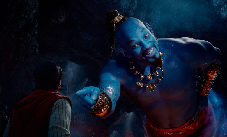 """This image released by Disney shows Mena Massoud as Aladdin, left, and Will Smith as Genie in Disney's live-action adaptation of the 1992 animated classic """"Aladdin."""" Rotten Tomatoes is taking another step to verify that users posting a rating of a movie have actually seen it. The review aggregator says Thursday, May 23, 2019, that users who have purchased tickets on Fandango will get a verified badge next to their review, beginning with films out this weekend like """"Booksmart"""" and """"Aladdin."""" (Disney via AP)"""