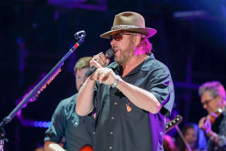 """FILE – In this June 10, 2016 file photo, Hank Williams Jr. performs at the CMA Music Festival at Nissan Stadium in Nashville, Tenn.  Williams Jr. is offering a $6,000 reward for his grandfather's missing shotgun. The singer known for hits including """"Family Tradition"""" has posted a letter online saying he spent time growing up in south Alabama with his grandfather. (Photo by Al Wagner/Invision/AP)"""