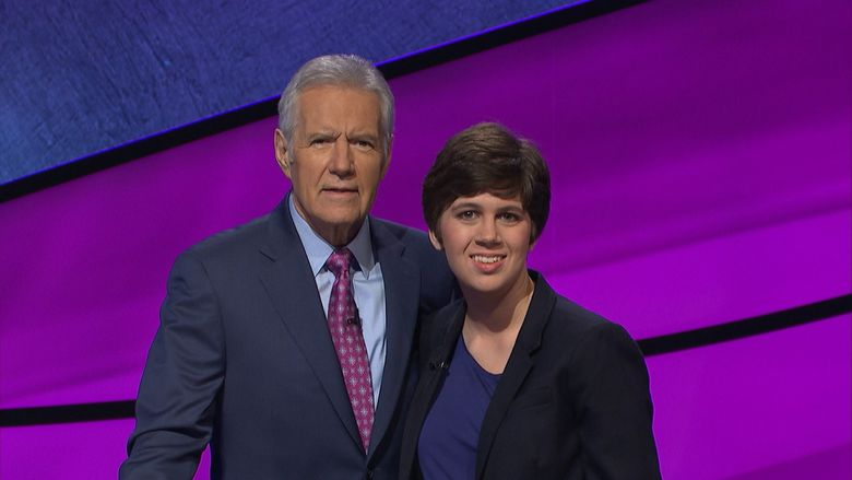"""University of Chicago librarian Emma Boettcher poses with """"Jeopardy!"""" host Alex Trebek. She goes up against champion James Holzhauer on Monday's episode.  (Jeopardy Productions / TNS)"""