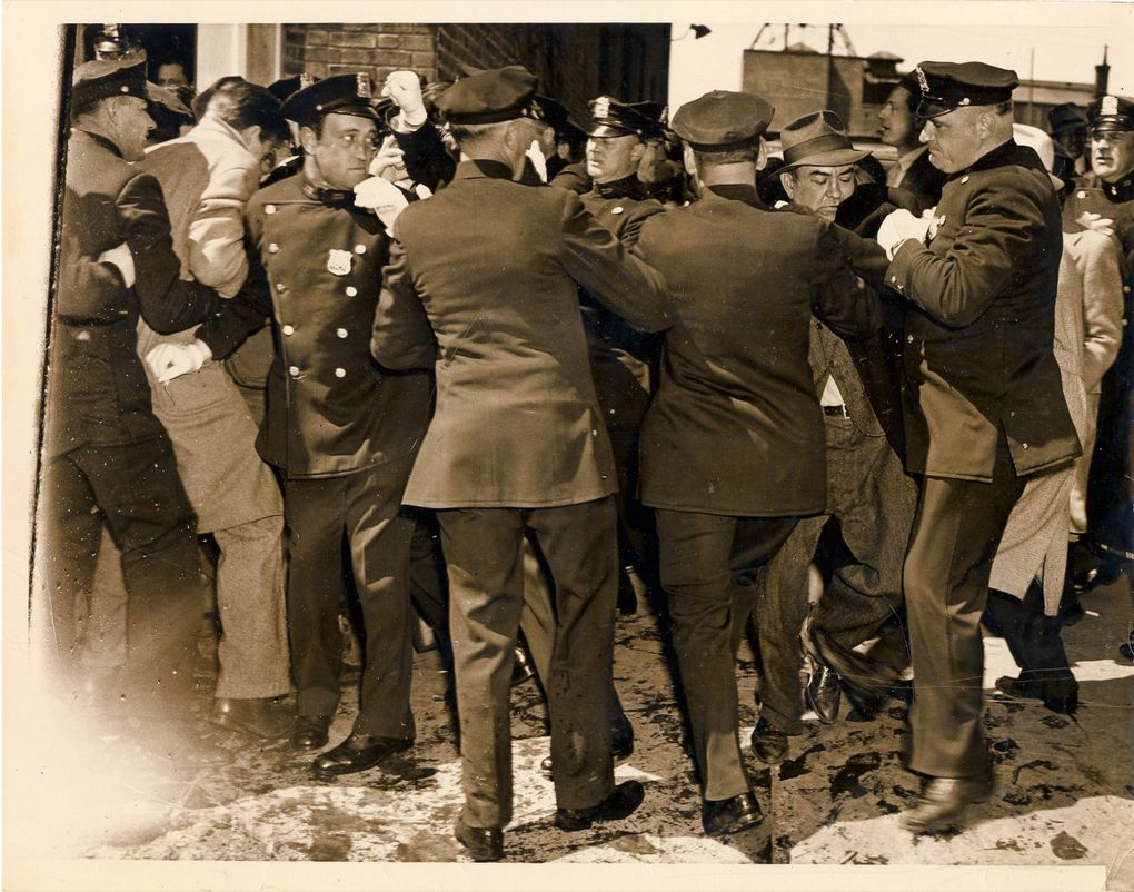 """In one of the Weegee images found by David Young, the caption reads: """"Cops battle strikers in picket line skirmish. Long Island Press bldg. 92-24 168th St., Jamaica, Queens, N.Y., April 24, 1937."""" (Copyright Weegee / International Center of Photography)"""
