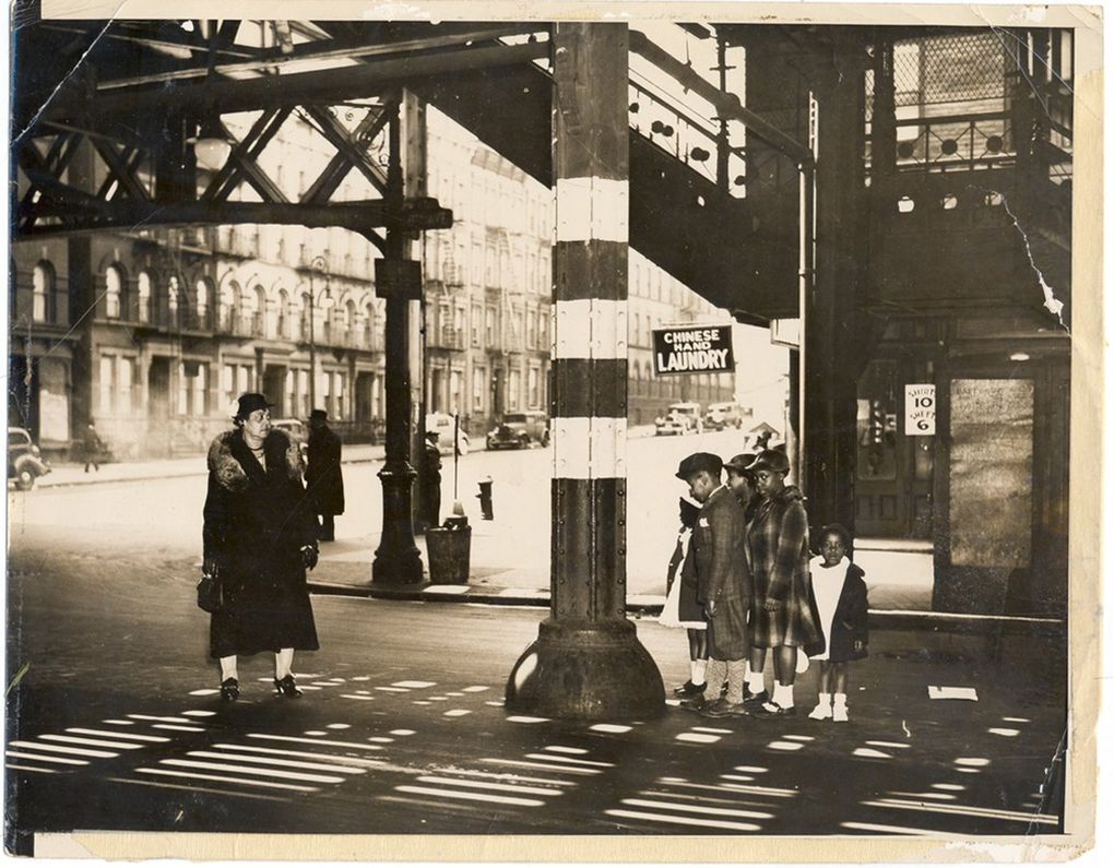"""One of many original photos by Weegee that David Young found. The caption reads: """"Woman and children under the el in Harlem, 135th st. and 8th Ave. April, 1937.""""  (Copyright Weegee / International Center of Photography)"""