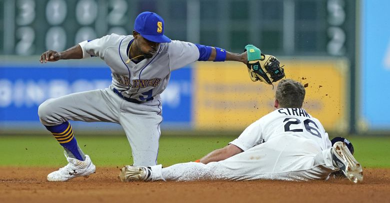 Houston Astros' Myles Straw (26) steals second base as Seattle Mariners' Dee Gordon (9) reaches to tag him during the seventh inning of a baseball game Friday, June 28, 2019, in Houston. (David J. Phillip / The Associated Press)
