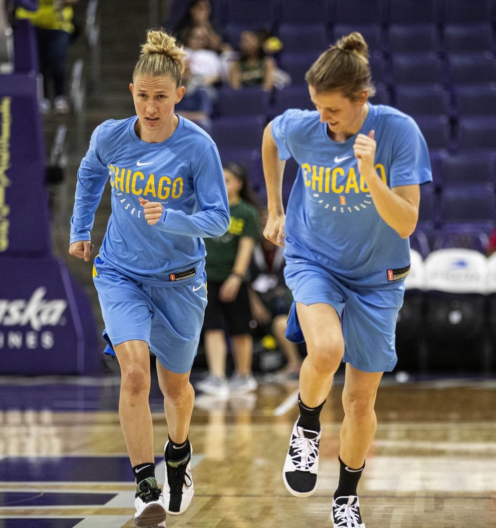 Courtney Vandersloot, left, and Allie Quigley are spouses and teammates on the Chicago Sky. (Dean Rutz / The Seattle Times)