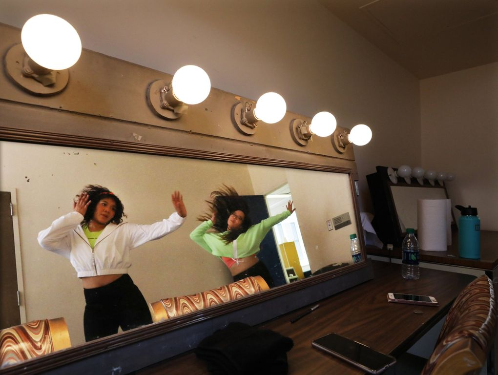 Corynn Smith and Miku Hanatate, with EmeRain, rehearse in the dressing room of the Broadway Performance Hall at Seattle Central College before the K-Pop auditions Friday. (Alan Berner / The Seattle Times)