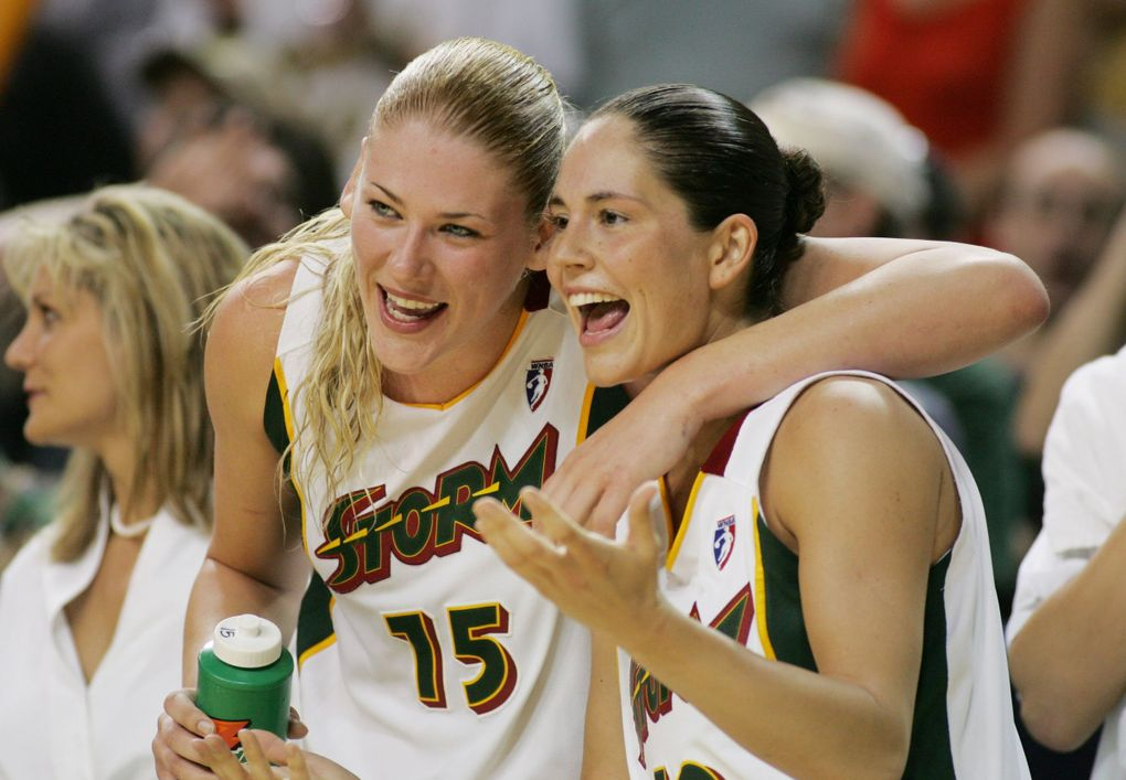 Lauren Jackson and Sue Bird enjoy the last seconds of their victory over Minnesota as the Storm takes another step toward the playoffs in 2005.  (Jim Bates / The Seattle Times)