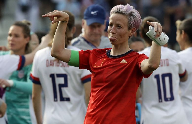 United States' Megan Rapinoe celebrates at the end of the Women's World Cup round of 16 soccer match between Spain and US at the Stade Auguste-Delaune in Reims, France. (Alessandra Tarantino / The Associated Press)
