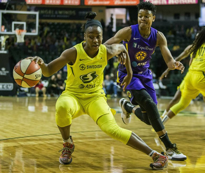 Seattle Storm's Jewell Loyd tries to get around Los Angeles Sparks' Alana Beard during a WNBA basketball game Friday, June 21, 2019, in Everett, Wash. (Olivia Vanni/The Herald via AP)