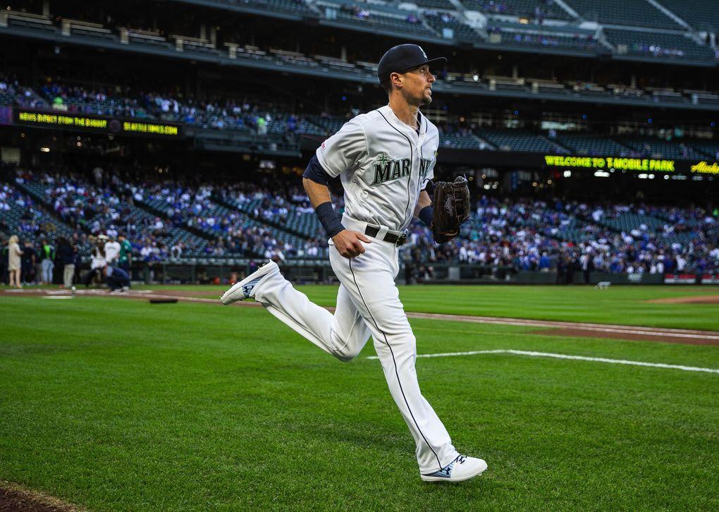 Braden Bishop runs onto the field in April. (Dean Rutz / The Seattle Times)