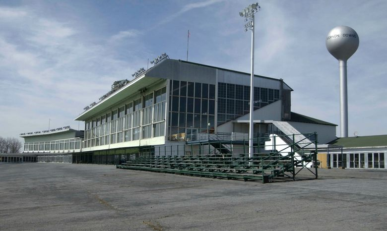FILE – This March 30, 2004 file photo, shows the grand stands at Vernon Downs in Verona, N.Y. A smaller Woodstock 50 festival could possibly be held at the upstate New York harness track and casino. Town of Vernon Supervisor Randy Watson tells the Poughkeepsie Journal that Woodstock 50 has applied for a permit to hold its concert Aug. 16-18, 2019, at Vernon Downs, about 35 miles east of Syracuse. Watson said the proposed capacity was 45,000-50,000 people – far smaller than the 150,000 planned for at the initial venue, Watkins Glen International.  (AP Photo/Kevin Rivoli, File)