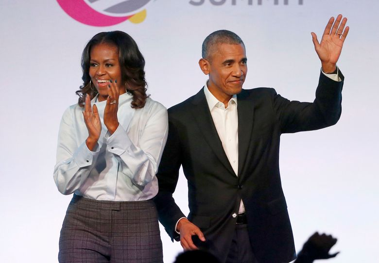 FILE – In this Oct. 31, 2017 file photo, former President Barack Obama, right, and former first lady Michelle Obama appear at the Obama Foundation Summit in Chicago. The couple's production company is teaming up with Spotify to produce exclusive podcasts for the platform. Under the Higher Ground partnership announced Thursday, June 6, 2019, the former president and first lady will develop and lend their voices to select podcasts on wide-ranging topics to connect with listeners around the world.   (AP Photo/Charles Rex Arbogast, File)