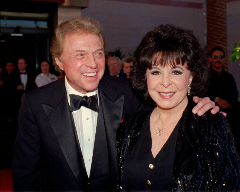 """FILE – In this May 30,1998 file photo, singer Steve Lawrence and his Eydie Gorme arrive at the black-tie gala called """"Thanks Frank"""" honoring Frank Sinatra in Las Vegas. Lawrence has been diagnosed with the early stages of Alzheimer's Disease. In a letter sent by his spokesman Howard Bragman on Tuesday, June 11, 2019, Lawrence confirmed the diagnosis. The 83-year-old performer is known for solo hits including the ballad """"Go Away Little Girl"""" and as one half of the 1960s pop duo Steve and Eydie alongside his wife, Eydie Gorme who died in 2013. (AP Photo/Lennox McLendon, File)"""
