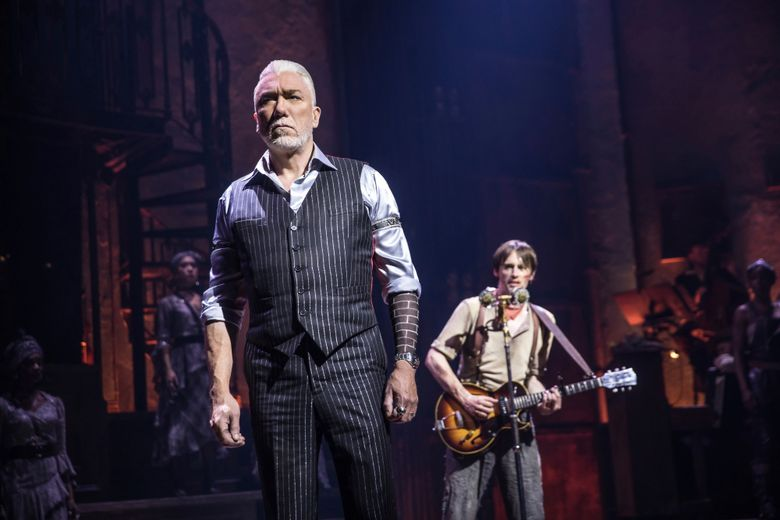 """This image released by DKC O&M Co. shows Patrick Page, left, and Reeve Carney during a performance of """"Hadestown,"""" directed by Rachel Chavkin. (Matthew Murphy/DKC O&M Co. via AP)"""