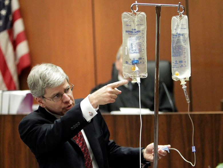 FILE – In this Thursday, Oct. 20, 2011 file photo, anesthesiology expert Dr. Steven Shafer demonstrates the use of propofol after placing a bottle of the drug in an empty saline bag during Dr. Conrad Murray's involuntary manslaughter trial for Michael Jackson's death in Los Angeles. Jackson died 10 years ago at his Los Angeles home after receiving a lethal dose of the drug intended for use only during surgery and other medical procedures _ not for insomnia. (AP Photo/Reed Saxon, Pool)