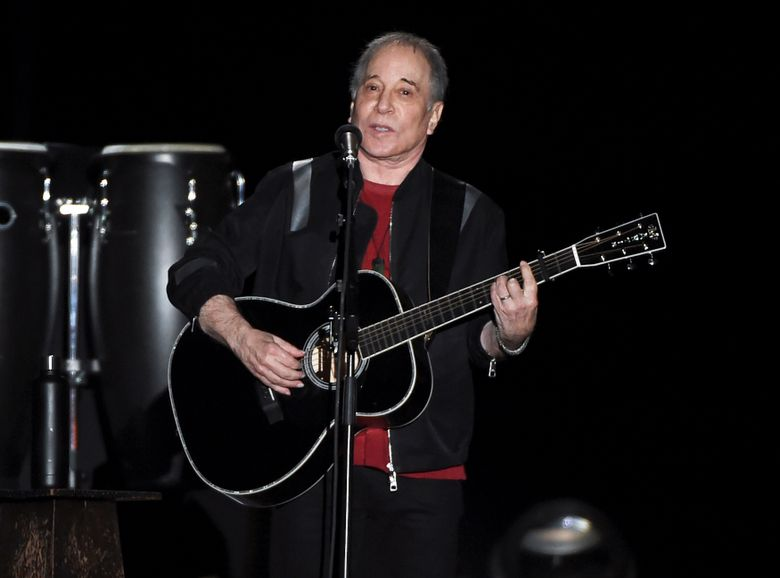 FILE – This Sept. 22, 2018 file photo shows singer-songwriter Paul Simon performing in Flushing Meadows Corona Park during the final stop of his Homeward Bound – The Farewell Tour in New York. Simon was honored by the Poetry Society of America and celebrated by reading a couple of poems and singing a few songs. During a dinner benefit Tuesday night, June 18, 2019, at the New York Botanical Garden, Simon and poetry editor Alice Quinn were praised for their love for language. Quinn is the former poetry editor for The New Yorker and is stepping down as the poetry society's executive editor. Simon is regarded as among the first composers to bring a consciously literary sensibility to rock music.(Photo by Evan Agostini/Invision/AP, File)