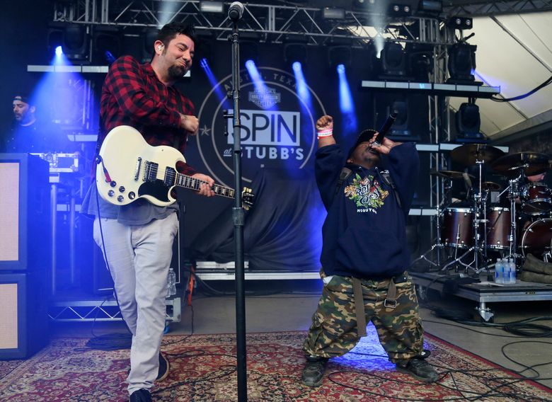 FILE – In this March 18, 2016, photo Bushwick Bill, right, joins Deftones' Chino Moreno onstage at the SPIN Party at Stubb's during the South by Southwest Music Festival in Austin, Texas. A publicist for rapper Bushwick Bill says the founder of the iconic Houston rap group the Geto Boys has died. Bill's publicist, Dawn P., told The Associated Press that the rapper died Sunday, June 9, 2019, at a Colorado hospital.  (Photo by Jack Plunkett/Invision/AP, File)