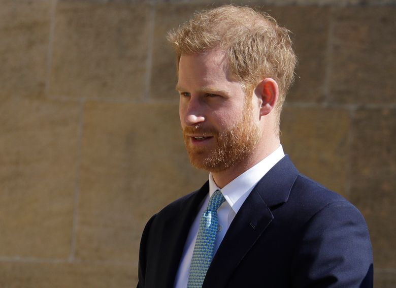 FILE – In this Sunday, April 21, 2019 file photo, Britain's Prince Harry arrives to attend the Easter Mattins Service at St. George's Chapel, at Windsor Castle in England. Prince Harry is offering his support to Angola's new 47 million pound ($60 million) initiative to clear land-mines, saying it will protect lives and help communities through conservation-led development. Speaking Monday at the Chatham House think tank, Harry picked up the mantle for a cause near to the heart of his mother, the late Princess Diana, who worked with the Halo Trust on de-mining issues. (AP Photo/Kirsty Wigglesworth, file)