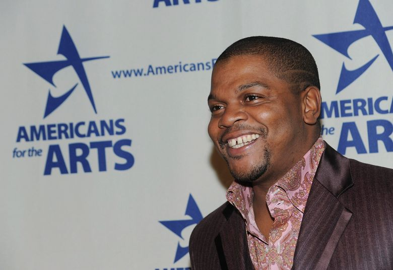 """FILE – In this Oct. 6, 2008 file photo, Artist Kehinde Wiley attends the 2008 National Arts Awards presented by Americans For The Arts at Cipriani's 42nd St.  in New York.  Wiley will unveil in New York's Time Square his first monumental public sculpture in response to Confederate sculptures throughout the U.S.  Times Square Arts, the Virginia Museum of Fine Arts and Sean Kelly announced Thursday, June 20, 2019  that """"Rumors of War"""" will feature a bronze sculpture of a young, African-American dressed in urban streetwear mounted atop a horse.  (AP Photo/Evan Agostini, File)"""