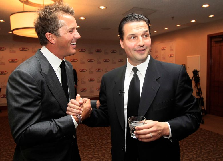 FILE – In this Monday, Oct. 15, 2012, file photo, hockey greats Mike Modano, left, and Eddie Olczyk shake hands before the U.S. Hockey Hall of Fame class of 2012 induction dinner in Dallas. Olczyk already bounces back and forth during the spring between the NHL playoffs and horse racing's Triple Crown. Now he's adding a new stop on his pucks and ponies tour. Olczyk will go from the broadcast booth at TD Garden for Game 7 of the Stanley Cup Final to Ascot Racecourse in England to work his first Royal Ascot. (AP Photo/LM Otero, File)