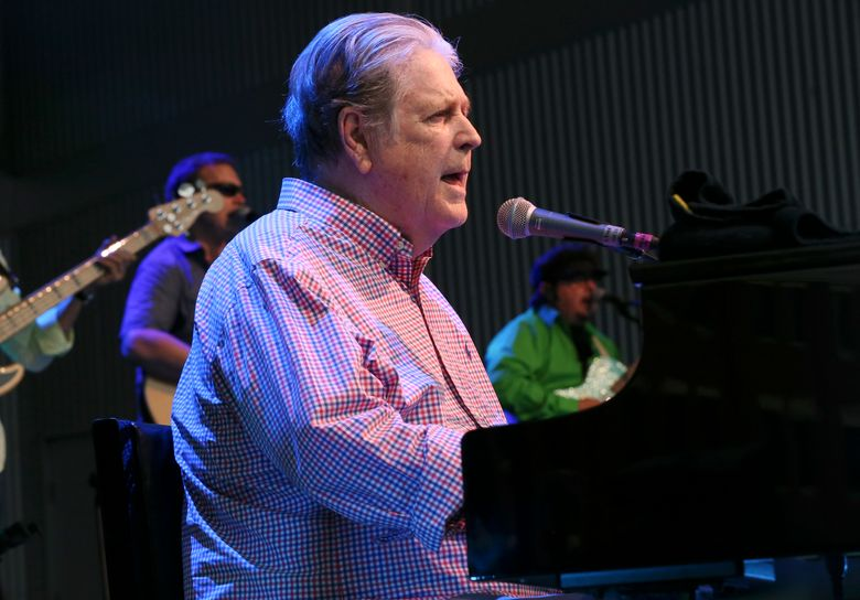 """FILE – In a Aug. 20, 2016 file photo, Brian Wilson performs at Elmwood Park Amphitheater in Roanoke, Va. Brian Wilson has postponed his upcoming June 2019 tour due to mental health concerns. The Beach Boys singer said in a statement Thursday, June 6, 2019 that he postponed the Pet Sounds and Greatest Hits Live tour after a recent surgery caused him to feel """"mentally insecure."""". (Heather Rousseau/The Roanoke Times via AP, File)"""