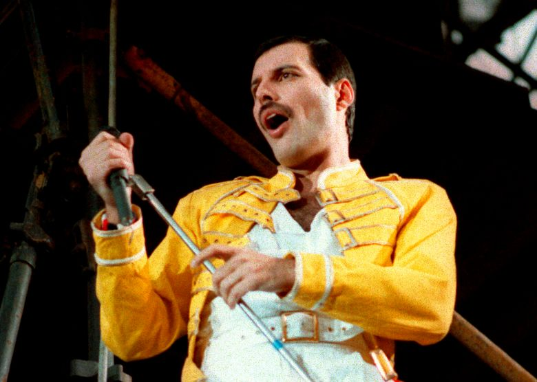 """FILE – In this July 20, 1986 file photo, Queen lead singer Freddie Mercury performs, in Germany.  A previously unheard and unreleased song by Mercury was released Thursday, June 20, 2019.  Universal Music announced that the track, """"Time Waits for No One,"""" was originally recorded in 1986 for the concept album of the musical """"Time"""" with musician Dave Clark. A video to accompany the song was also released and includes unseen performance footage of Mercury. It was recorded in April 1986 at London's Dominion Theatre.  (AP Photo/Marco Arndt, File)"""