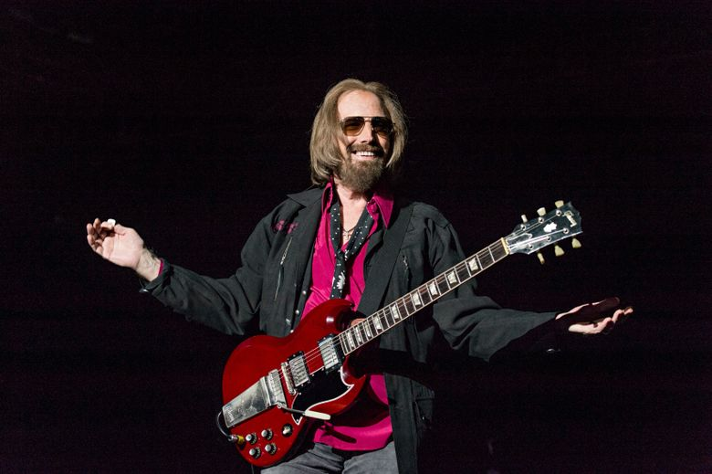 """FILE – In a Sunday, Sept. 17, 2017 file photo, Tom Petty and the Heartbreakers perform at KAABOO 2017 at the Del Mar Racetrack and Fairgrounds, in San Diego, Calif.  A California real estate agent and self-proclaimed """"super fan"""" says he's extended an offer to buy the Florida home of Petty. Kevin Beauchamp tells The Gainesville Sun he quickly made an offer of $175,000 for the nearly 1,200-square-foot (111-sq. meter) home after seeing the home's current owner Brandy Clark mention on a Petty Facebook fan club that she might sell it. (Photo by Amy Harris/Invision/AP, File)"""
