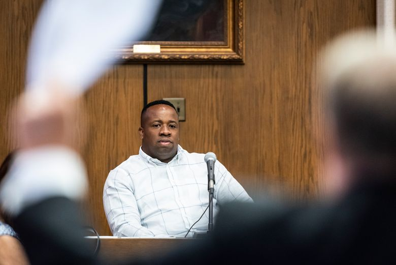 In this Monday, June 24, 2019 photo, rapper Yo Gotti, whose legal name is Mario Mims, looks on as attorney Clarke Dummit waves Yo Gotti's affidavit during a hearing in Winston-Salem, N.C.  A North Carolina judge is refusing to throw out a $6.6 million judgment against the rapper. Singer Young Fletcher's manager Michael Terry filed a lawsuit accusing Mims of shirking a $20,000 deal to rap on one of Young Fletcher's songs and thereby boost sales. Terry says Mims didn't sign paperwork necessary for putting the song on streaming services. (Andrew Dye/The Winston-Salem Journal via AP)