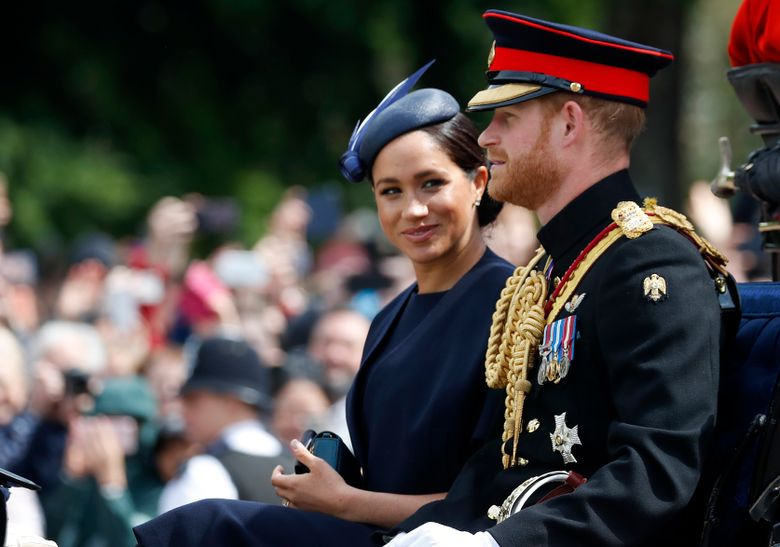 FILE – In this Saturday, June 8, 2019 file photo, Britain's Meghan, the Duchess of Sussex and Prince Harry ride in a carriage to attend the annual Trooping the Colour Ceremony in London. Kensington Palace says on Thursday, June 20 the Duke and Duchess of Sussex will be starting their own foundation to support their charitable endeavors, formally spinning off from the entity Prince Harry and Prince William established together a decade ago. (AP Photo/Frank Augstein, file)