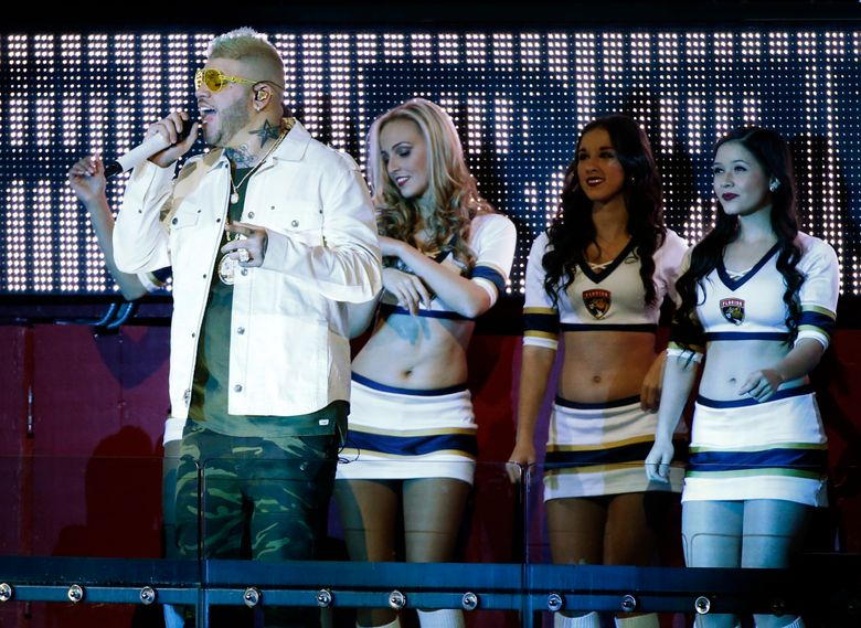 FILE – In this Jan. 31, 2017 file photo, Puerto Rican singer Farruko performs during the second period of an NHL hockey game between the Florida Panthers and the Ottawa Senators, Tuesday, in Sunrise, Fla. A judge on Thursday, June 13, 2019, has ordered three years' probation for Puerto Rican singer Farruko after he pleaded guilty to not declaring nearly $52,000 in cash discovered in his luggage and shoes last year. (AP Photo/Wilfredo Lee, File)