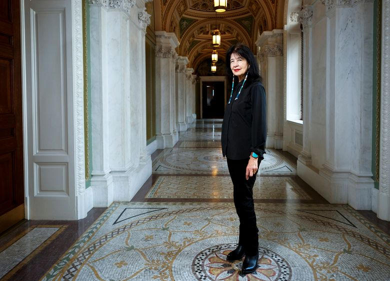 """In this June 6, 2019 photo, Joy Harjo, of the United States, poses inside the Library of Congress, in Washington. Harjo has been named the country's next poet laureate, becoming the first Native American to hold that position. Librarian of Congress Carla Hayden announced Harjo's appointment, saying in a statement Wednesday, June 19 that the poet helped tell an American story of continuity and disruption, """"reckoning and myth-making."""" Harjo's one-year term begins this fall. She succeeds Tracy K. Smith, who served two terms. (Shawn Miller/Library of Congress)"""