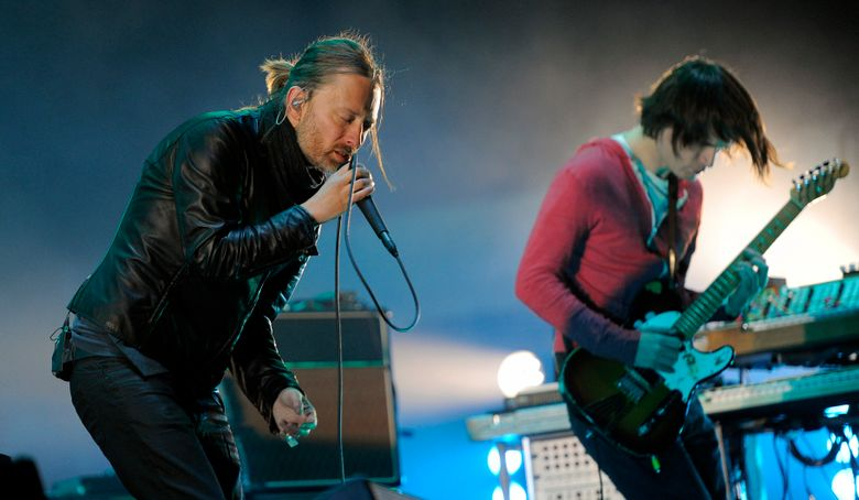 FILE – In this April 14, 2012 file photo, Thom Yorke, left, and Jonny Greenwood of Radiohead perform during the band's headlining set at the 2012 Coachella Valley Music and Arts Festival in Indio, Calif.  Radiohead says a trove of unreleased music has been stolen and is being used for ransom, but instead of paying up, the band announced Tuesday June 11, 2019, they will release it in aid of environmental activist group Extinction Rebellion.(AP Photo/Chris Pizzello, File)