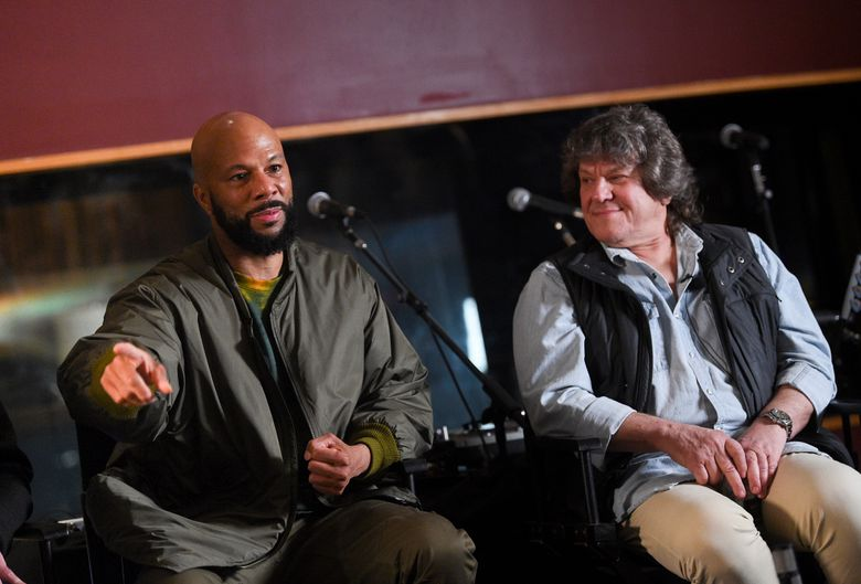 """FILE – In a March 19, 2019 file photo, hip hop recording artist Common, left, and Woodstock co-producer and co-founder, Michael Lang, participate in the Woodstock 50 lineup announcement at Electric Lady Studios, in New York. The fate of the Woodstock 50 festival is further in doubt after Watkins Glen International announced Monday, June 10, 2019 that it's not hosting the anniversary event. Watkins Glen issued a two-sentence statement Monday saying it had terminated the site license for the festival """"pursuant to provisions of the contract.""""(Photo by Evan Agostini/Invision/AP, File)"""