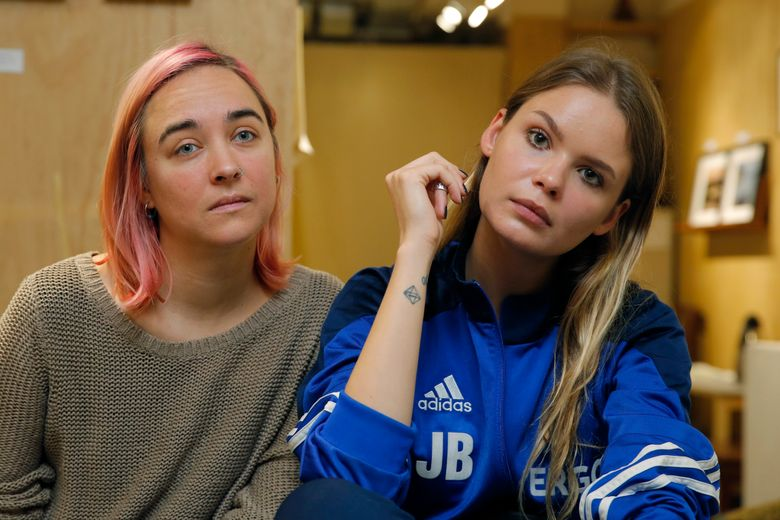 FILE – In this Nov. 3, 2018 file photo, two members of Russian punk band and political activists Pussy Riot, Veronica Nikulshina, right, and Olga Kuracheva attend a dialogue on art and freedom of expression, in response to the cancellation of Badiucao's exhibition in Hong Kong. The Russian protest band is planning a concert in Alabama to benefit Planned Parenthood after the state passed the nation's toughest anti-abortion law. Al.com reports that the feminist band is set to perform July 11, 2019, at a music venue in Birmingham. (AP Photo/Kin Cheung, File)
