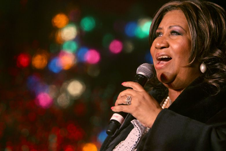 """FILE – In this Dec. 4, 2008 file photo, Aretha Franklin performs during the 85th annual Christmas tree lighting at the New York Stock Exchange in New York. A fight is emerging over whether a son of Aretha Franklin could be put in charge of the late singer's estate, which might be worth millions. In a court filing Monday, June 17, 2019, lawyers for the estate say """"there is no basis"""" to believe that Kecalf (Kelf) Franklin has the skills to serve as personal representative, even if a handwritten will found in couch cushions turns out to be valid. (AP Photo/Mary Altaffer, File)"""