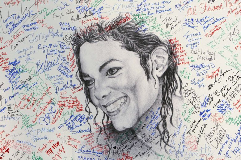 FILE – This July 7, 2009 file photo shows signatures on a poster of the late pop icon Michael Jackson at the Charles H. Wright Museum of African American History in Detroit. Tuesday, June 25, 2019, marks the tenth anniversary of Jackson's death. (AP Photo/Carlos Osorio, File)