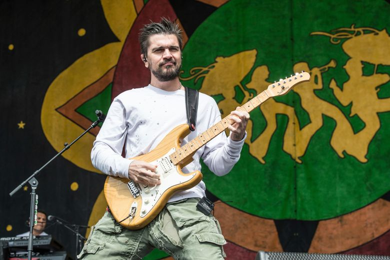 FILE – In this May 5, 2018 file photo, Juanes performs at the New Orleans Jazz and Heritage Festival in New Orleans. Juanes has been named 2019 Latin Recording Academy Person of the Year. The academy will honor the 22-time Latin Grammy Award winner and two-time Grammy Award winner on Nov. 13, 2019 at the MGM Grand Convention Center in Las Vegas, on the eve of the Latin Grammys. (Photo by Amy Harris/Invision/AP, File)