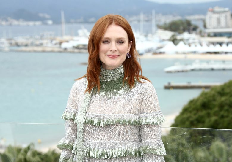 FILE – In this Friday, May 17, 2019 file photo, Julianne Moore poses for photographers at the photo call for the film 'The Staggering Girl' at the 72nd international film festival, Cannes, southern France. The international film international at the Czech spa of Karlovy Vary will honor U.S. Oscar-winning actress Julianne Moore for her outstanding contribution to world cinema. The festival opens on June 28, 2019. (Photo by Joel C Ryan/Invision/AP, File)