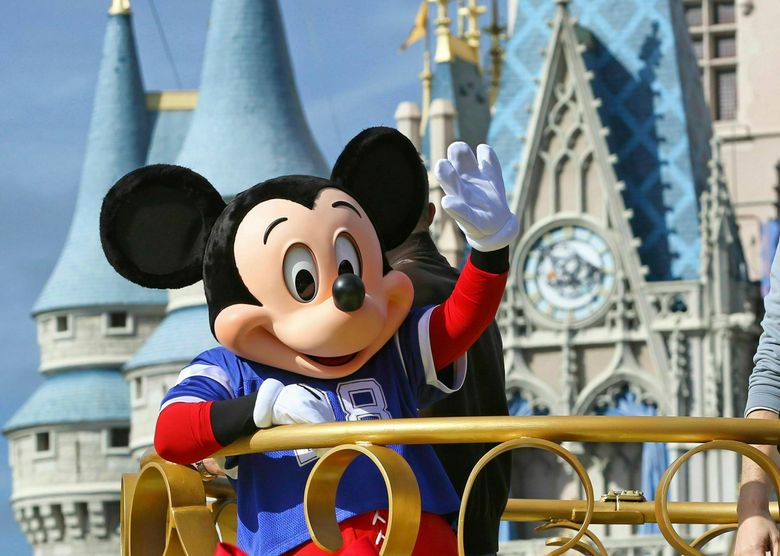 """FILE – In this Feb. 4, 2019, file photo, Mickey Mouse celebrates the Super Bowl winning team, the New England Patriots, during the Super Bowl victory parade in the Magic Kingdom at Walt Disney World in Lake Buena Vista, Fla. Months after workers who play Mickey Mouse and Goofy at Walt Disney World threatened to leave the Teamsters union because of what they called """"horrible misrepresentation,"""" General President James Hoffa has appointed two associates to take over the local union in Orlando, Fla., according to a letter from Hoffa posted Monday, June 24, to the doors of the Local 385 union hall. (Joe Burbank/Orlando Sentinel via AP, File)"""