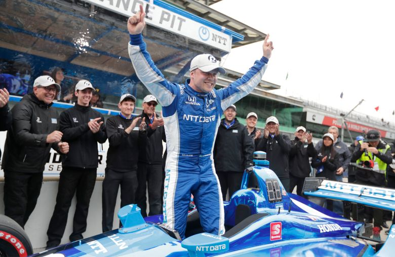 FILE – In this May 10, 2019, file photo, Felix Rosenqvist, of Sweden, celebrates after winning the pole during qualifications for the Indy GP IndyCar auto race at Indianapolis Motor Speedway in Indianapolis. Rosenqvist leads all rookies in the IndyCar series this season with 209 points after finishing sixth with a car that qualified just 18th last weekend at Road America. (AP Photo/Michael Conroy, File)