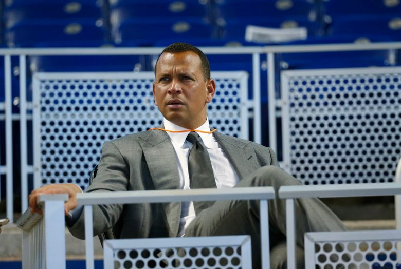 """FILE – In this June 23, 2017, file photo, former baseball player Alex Rodriguez sits in the stands before the start of a baseball game in Miami. Rodriguez said he is happy with the improvements he has made in his second year in the booth for ESPN's """"Sunday Night Baseball"""", but he is looking to get better during the second half of the season. (AP Photo/Wilfredo Lee, File)"""